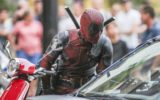 Ryan Reynolds rides a scooter while Zazie Beetz chases on a motorcycle on Deadpool 2